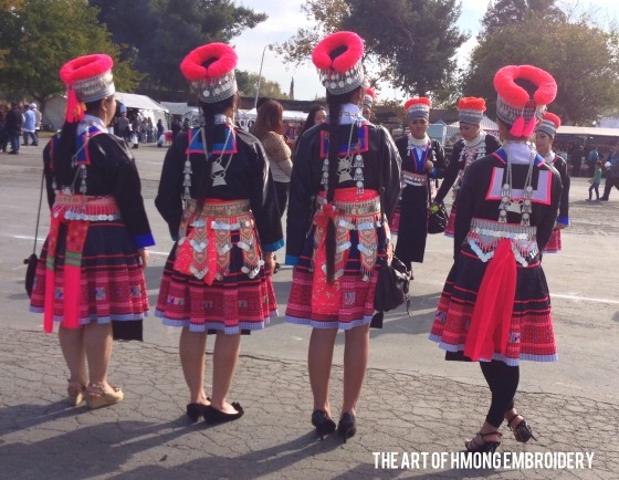 Girls dressed in authentic, traditional Black Hmong clothes from the back.